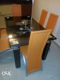 Brand new glass dining table with orange chairs 0