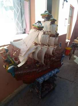 Wooden matchstick boat and Lion