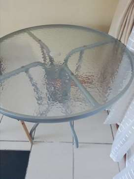 """Patio table with umbrella black in the middle.i or"""""""