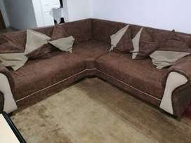 L shape couches with pillows