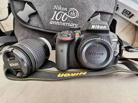 Brand new Nikon D3400 with a sealed new tripod stand for sale, memory