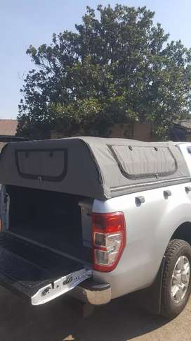 Ranger canvas canopy with gas lift door and cattle rail