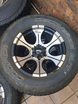 """5 x 17"""" Dick Cepek mags and Cooper tyres"""