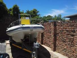 Boat and trailer with safety equipment