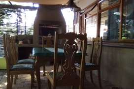 Wooden dinner table and 6 chairs