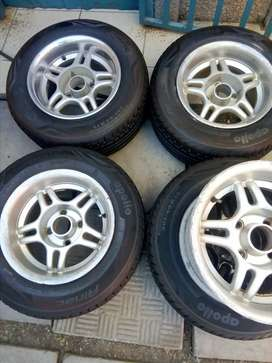 4 hole deep dish mags pcd 108 with balloon tyres. Size 13