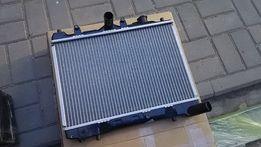 Радиатор двигателя для Mazda 323 (85-89).