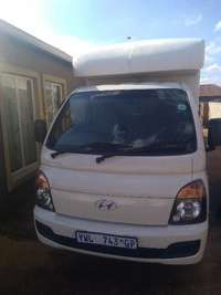Image of Hyundai H100 bakkie with Canpoy for HiRE- Beat the rain!!!