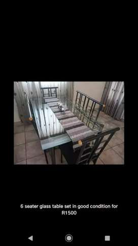 6 seater glass table for Sale R1800 neg.