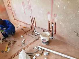 Plumbers and electricians drain geyser stove ovens