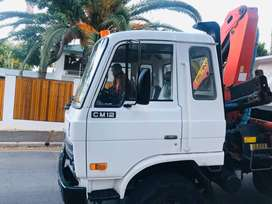 Tipper truck With a hydraulic crane for sale