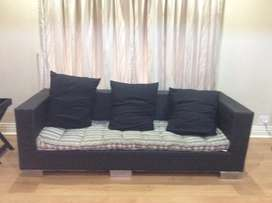 Plastic wicker couch with cushion
