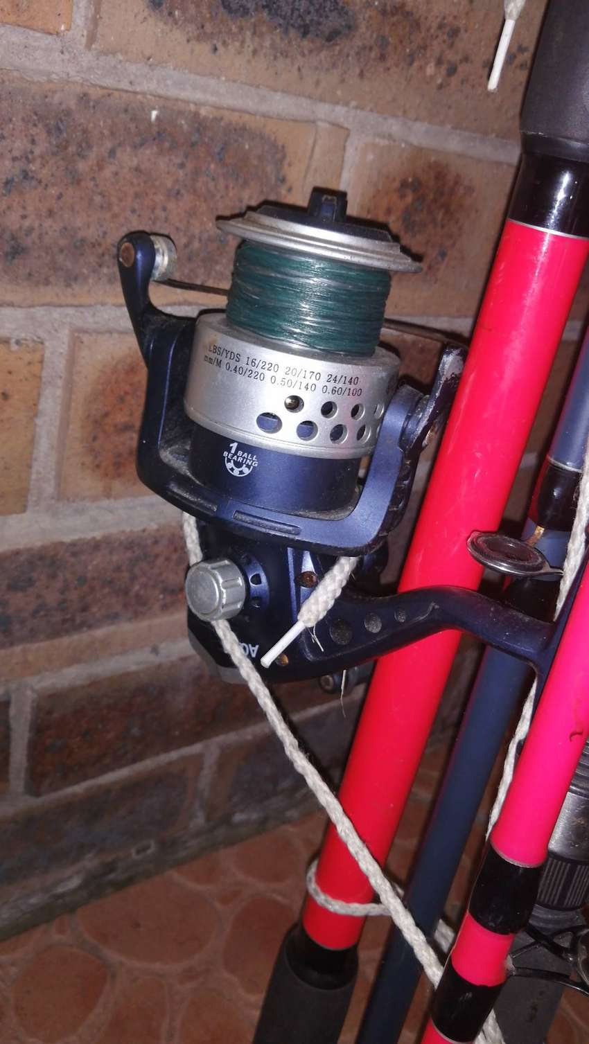2 fishing rods and a reel .message for more info. e ro4 0