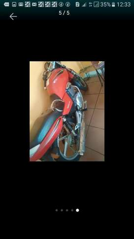 Its a good running 125cc motorbike, licensed but behind with payment