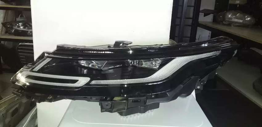 UP FOR SALE IS A RANGE ROVER EVOQUE LEFT SIDE HEADLIGHT AVAILABLE 0