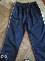 Spodnie sportowe długie R. M Pas 72 cm