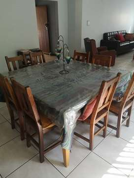 8 seater dining table with chairs.