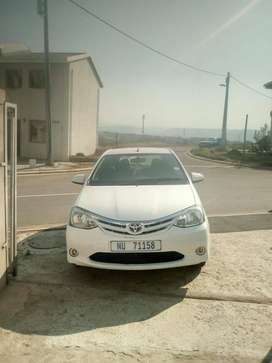Toyota etios hatch back2013 model white in color