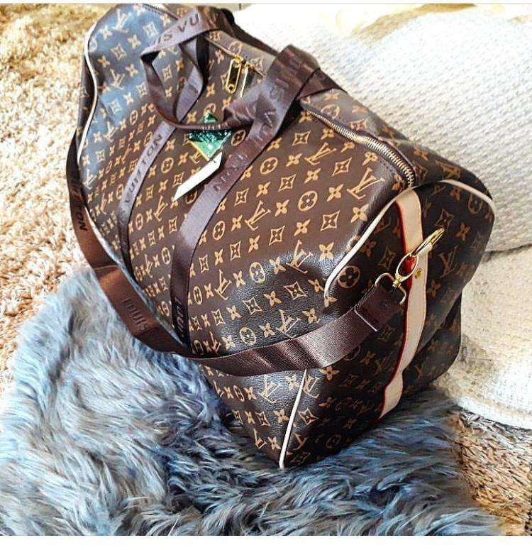 Louis vuitton travelling bag 0