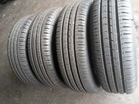 A set of still rims and tyres polo vivo size 185/70/14 for sale