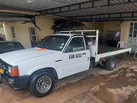 Ford courier for sale comes with flatbed