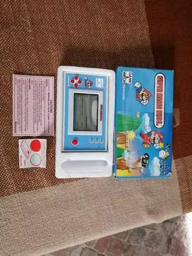 Old vintage Nintendo game and watch hand game Super Mario Bros