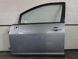 Дверка дверь двери передні ліві Nissan Tiida 04-12p.