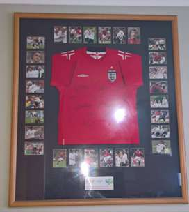 Framed England away football shirt signed by 15 players 2006 world