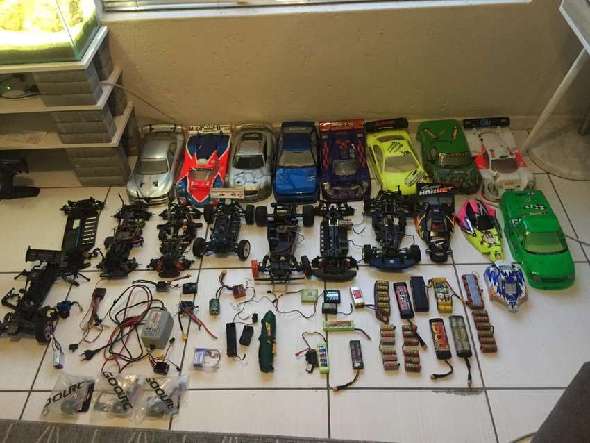 RC remotes, incomplete cars and other spares 0