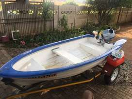 Fishing boat with 5hp Honda motor