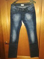 Granatowe jeansy - przecierki - rurki - biodrówki rozm. 40/L
