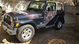 Jeep 2 door. Wrapped black ops. One size over wheels