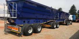 MINNING 34 TON SIDE TIPPER TRUCKS FOR HIRE.