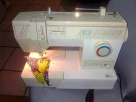 Singer Harmonie sewing machine for sale R1250 recently serviced 100% w