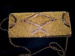 Клач ручной работы из золотистого бисера.