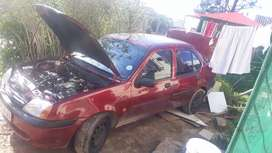 Am selling my ford ikon meroon in colour good condition