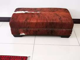 Cow hide ottoman in exceptional condition.