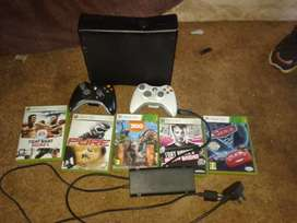 Xbox 360 with two remotes and games
