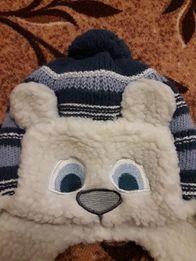 Теплая шапка на овчине.