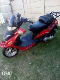 Image of Sykgo red scooter for sale