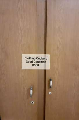 SECOND HAND CLOTHING CUPBOARD