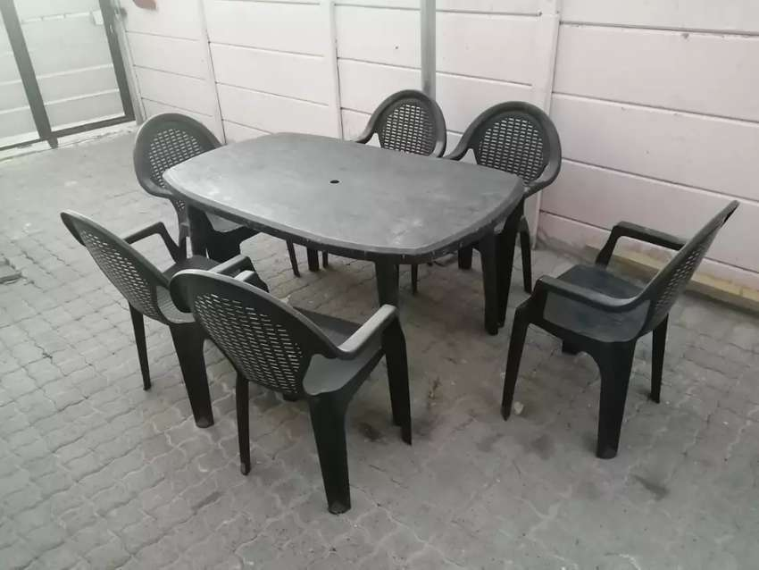 Plastic table and chairs (6)
