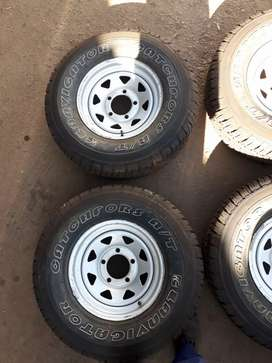 Land Cruiser 5 hole rims and 265/75/16 tyres. Land Rover Defender