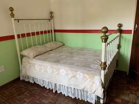 Antique white and copper double bed