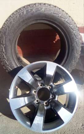 """18"""" Isuzu mag with brand new 255/60/18 all terrain tyre spare R27999"""