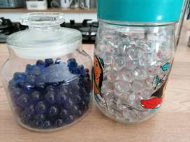 2 x JARS OF GLASS MARBLES