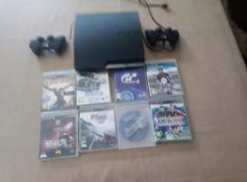 Playstation 3 for sale with 8 games and two controllers