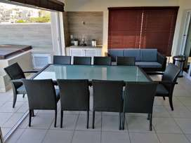 Wicker glasstop patio Table with 10 chairs in Ballito