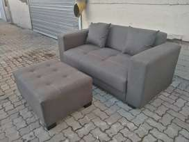 Brand new two seater couch +ottoman