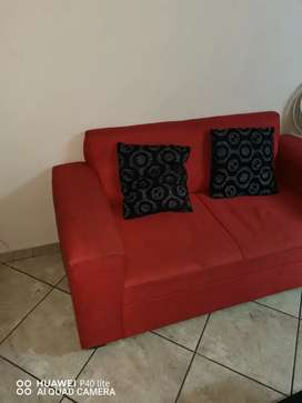 Two seater red couch
